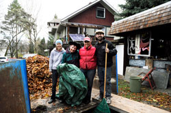 Julie Melanson, Christine Pilgrim, AJ Jaeger, and Andrew Mercer pile leaves for removal